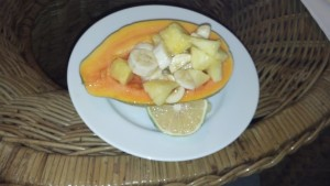 Papaya Halves filled with Pineapple and Banana slices.